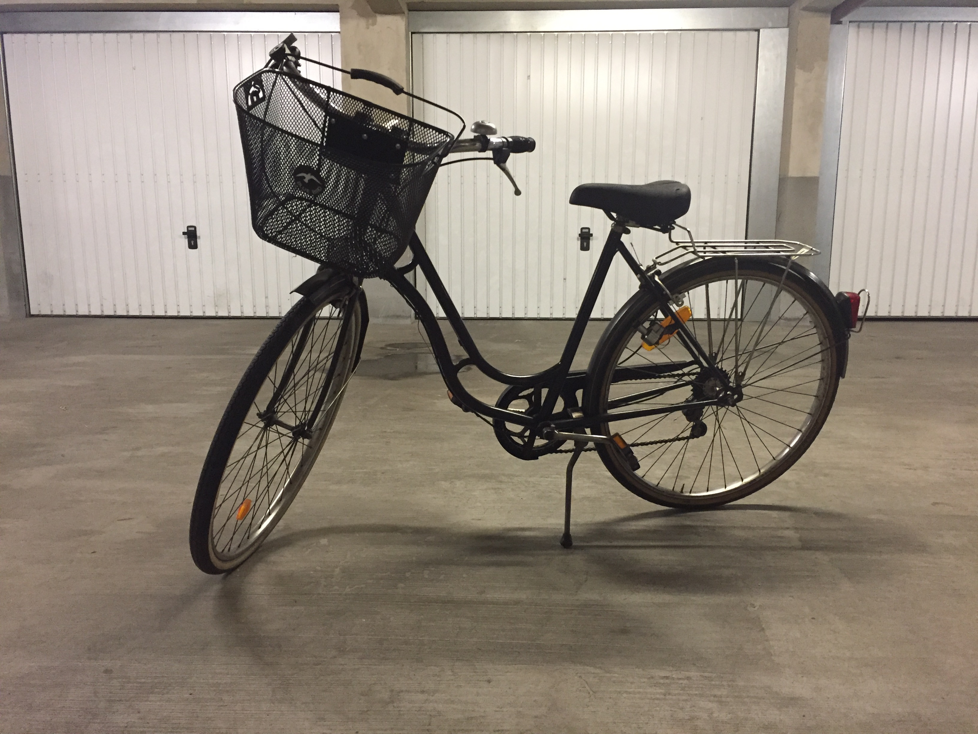 Black bicycle with basket