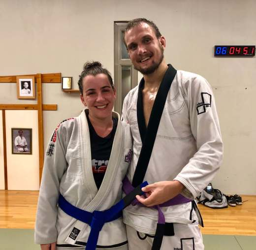 Brazilian Jiu Jitsu blue belt grading, couple smiling at the camera.